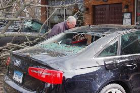Photo: Ken Borsuk / Hearst Connecticut Media -Greenwich resident Larry Simon looks at a vehicle damaged during Friday's nor'easter that could be seen outisde the Old Greenwich Social Club in Conn., Saturday, March 3, 2018.