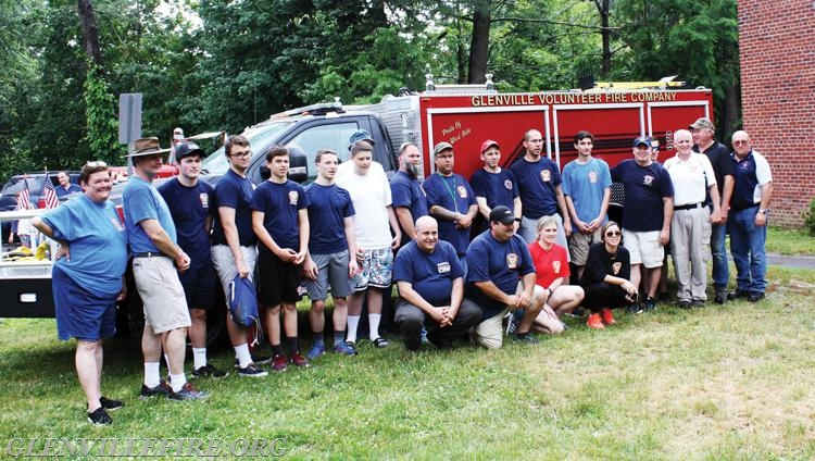 Members of the Glenville Volunteer Fire Company pose for a photo in front of their new brush truck.