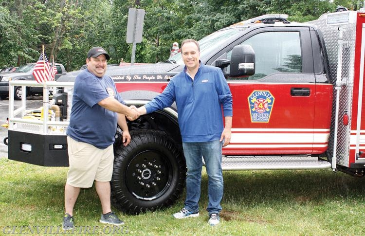 Greenwich First Selectman Peter Tesei helps to officially welcome the new brush truck to Glenville.