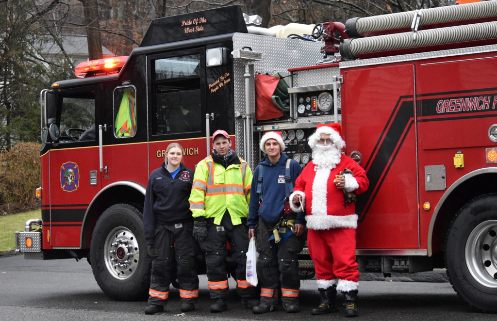 Glenville Volunteer Fire Company firefighters Karlie Darmochwal, Mark Horvath, Jeffrey Raiente and Santa (Martin Blanco). Dec 16, 2018 Photo: Heather Brown Lowthert