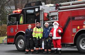 Glenville Volunteer Fire Company firefighters Karlie Darmochwal, Mark Horvath, Jeffrey Raiente and Santa (Martin Blanco). Dec 16, 2018 Photo: Heather Brown Lowthert