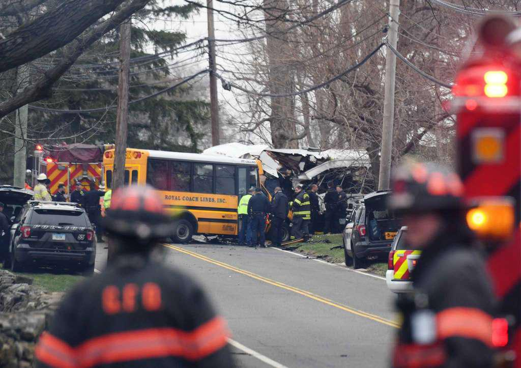 Police, EMS and firefighters respond to a school bus crash on King Street near Brunswick School in Greenwich, Conn. Tuesday, April 9, 2019 Photo: Tyler Sizemore / Hearst Connecticut Media