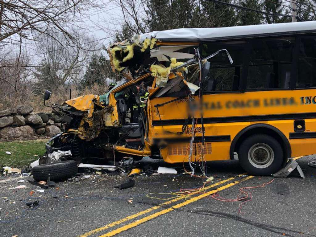 Police, EMS and firefighters respond to a school bus crash on King Street near Brunswick School in Greenwich, Conn. Tuesday, April 9, 2019. Photo: Contributed Photo / Contributed Photo