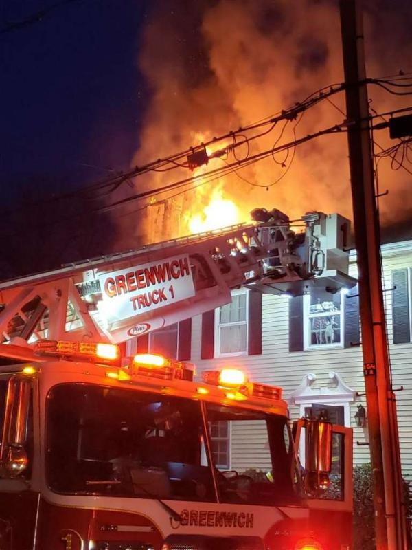 Photo: / Contributed Photo /Greenwich Fire Department Two Greenwich residents escaped early Sunday morning from a fire that severely damaged their home.