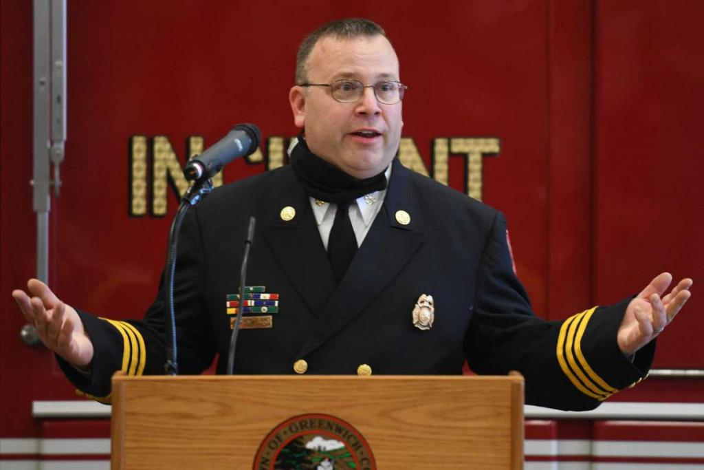 Tyler Sizemore / Hearst Connecticut Media Brian Koczak speaks after being promoted to Assistant Fire Chief at the Public Safety Complex in Greenwich, Conn. Monday, Oct. 26, 2020.