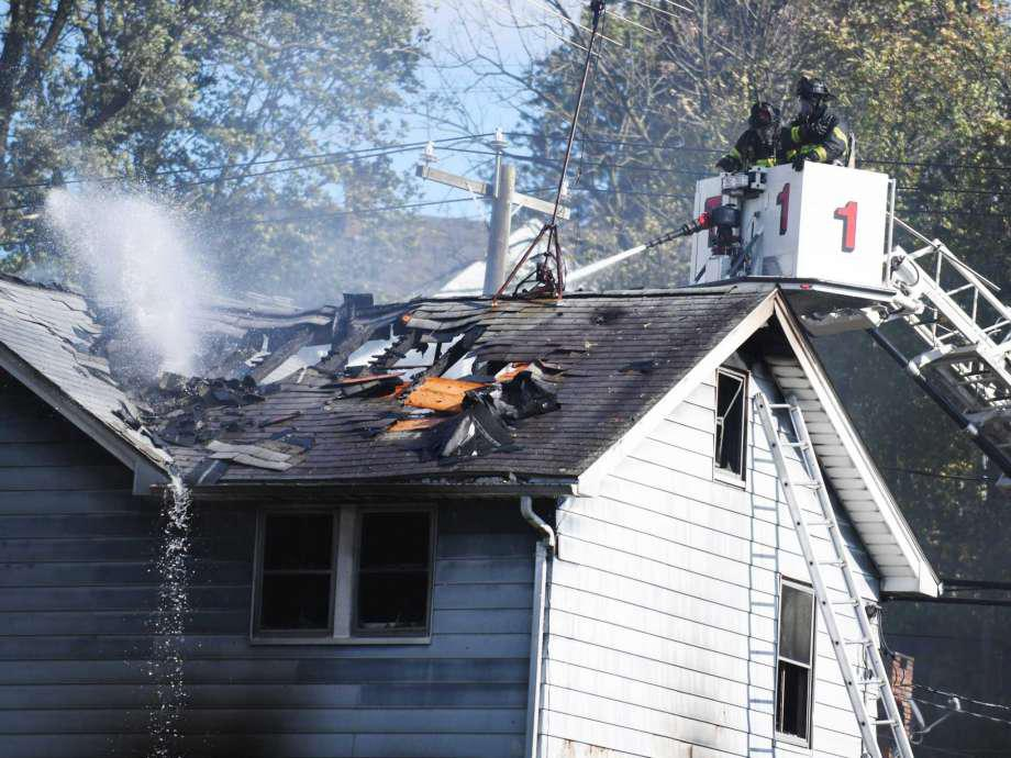 Greenwich firefighters extinguish a blaze on North Water Street in the Byram section of Greenwich, Conn. Monday, Nov. 2, 2020.